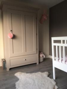 de babykamer van Amy
